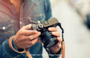 photographer adjusting camera lens